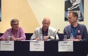 Fred Koblinger mit Jurypräsident Rob Reilly und Cannes-CEO Philip Thomas.