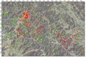 Ein beispielhafter rund tausend Quadratkilometer großer Ausschnitt aus einem Landsat-Satellitenbild von Nordrumänien. Die Farben zeigen den Waldverlust in unterschiedlichen Zeitperioden: blau 1988-89; gelb 1989-94; grün 1994-2002; orange 2002-2006; rot 2006-2009.