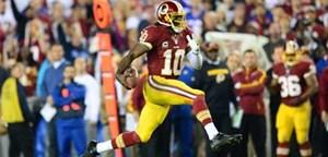 Der Rookie des Jahres der Endzone: Robert Griffin III lief sich heuer nicht nur in die Herzen der Redskins Fans. Neujahrswunsch: G'sund bleiben!