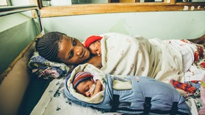 Brenda Nalubegas newborn sleeps in a Embrace Warmer which regulates body temperature.